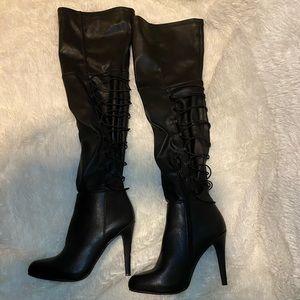 Over the knee, high heel boots.